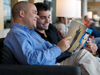 Couple reading in Admirals Club lounge