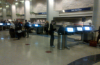 An American Airlines customer uses the new self-service machines in AA Terminal 4 at LAX