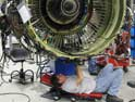 Tim Peth, AA Aircraft Maintenance Tech, works to kreduce engine maintenance time